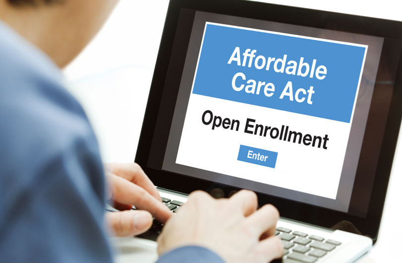 man-signing-up-for-affordable-care-act-during-open-enrollment