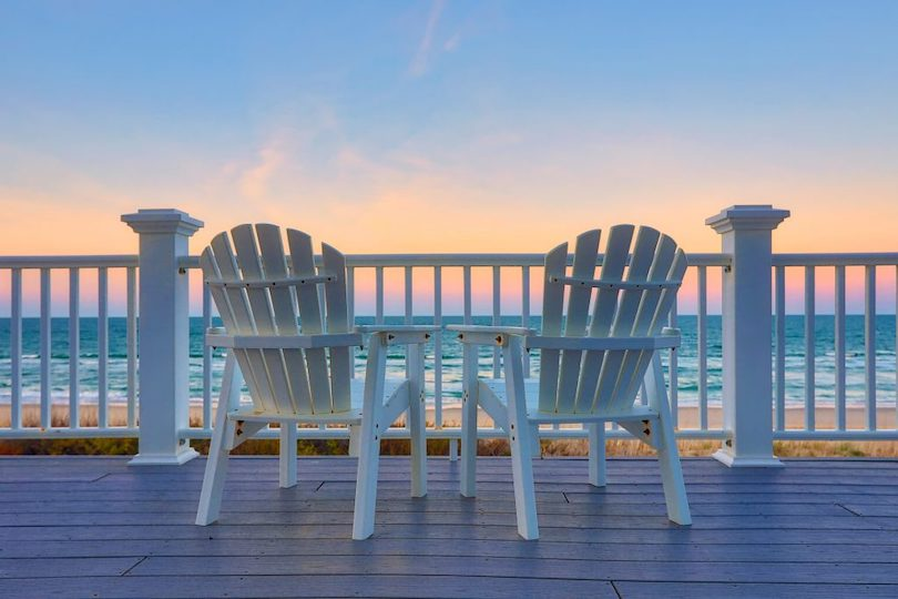 Adirondack chairs overlooking ocean