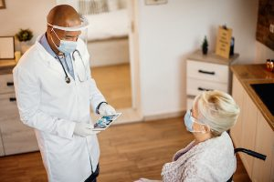 african american doctor with elderly patient
