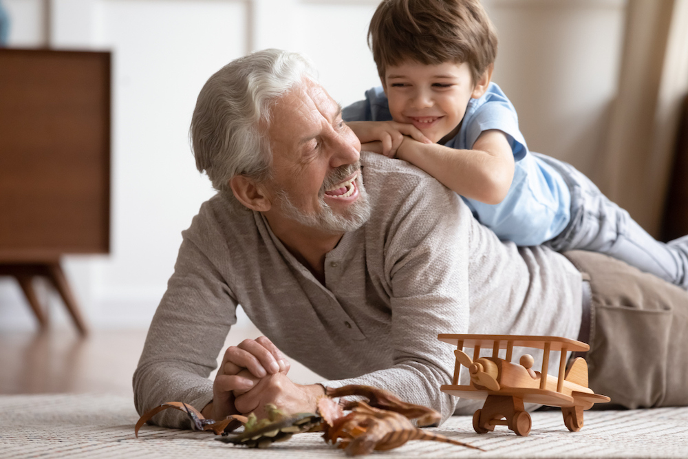 happy grandfather and grandchild playing