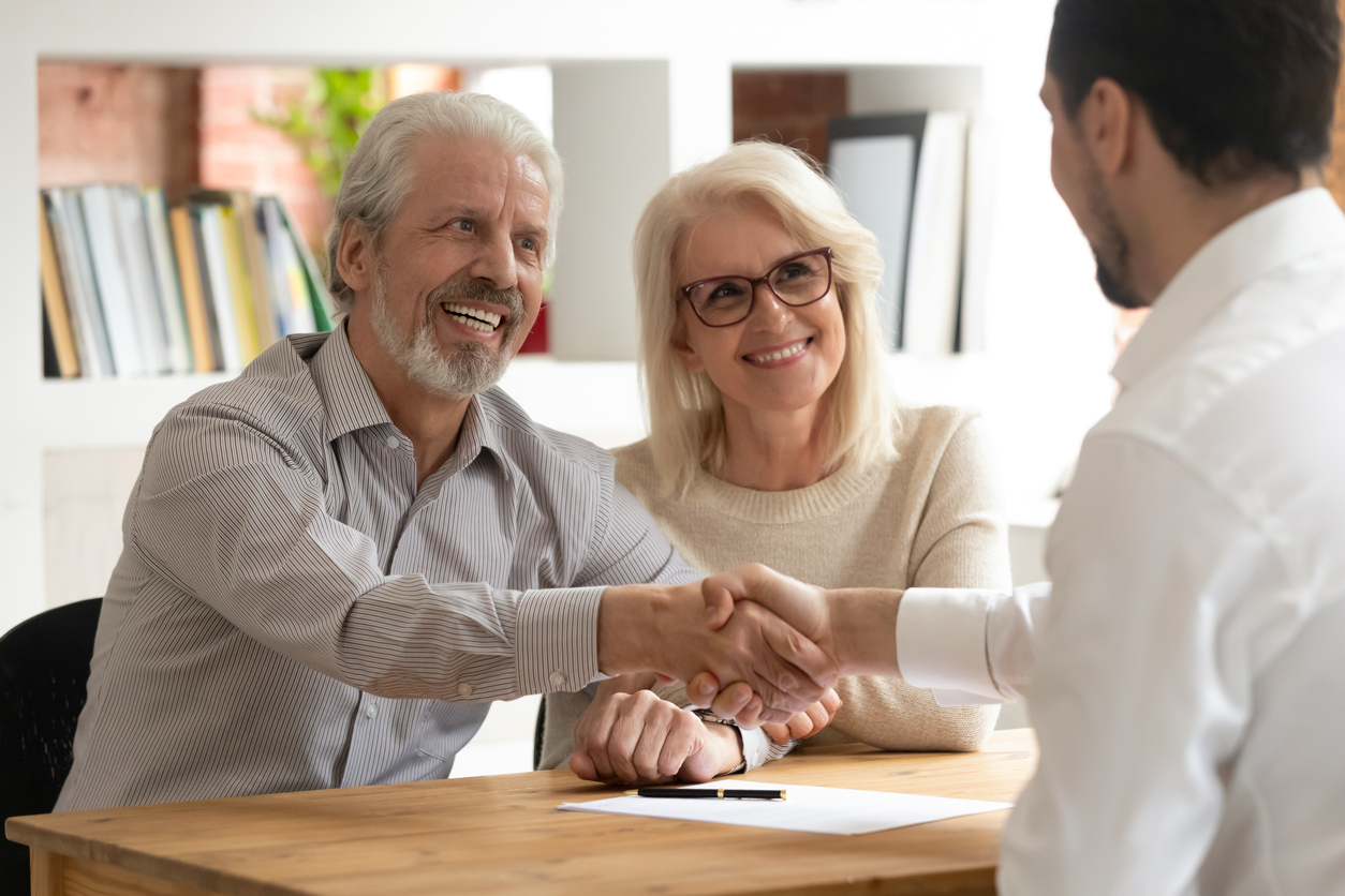 Senior Couple Working with Medicare Insurance Agent