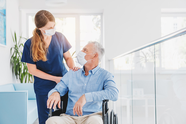 young nurse and male elderly patient