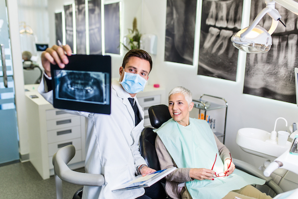 dentist and elderly patient review xray