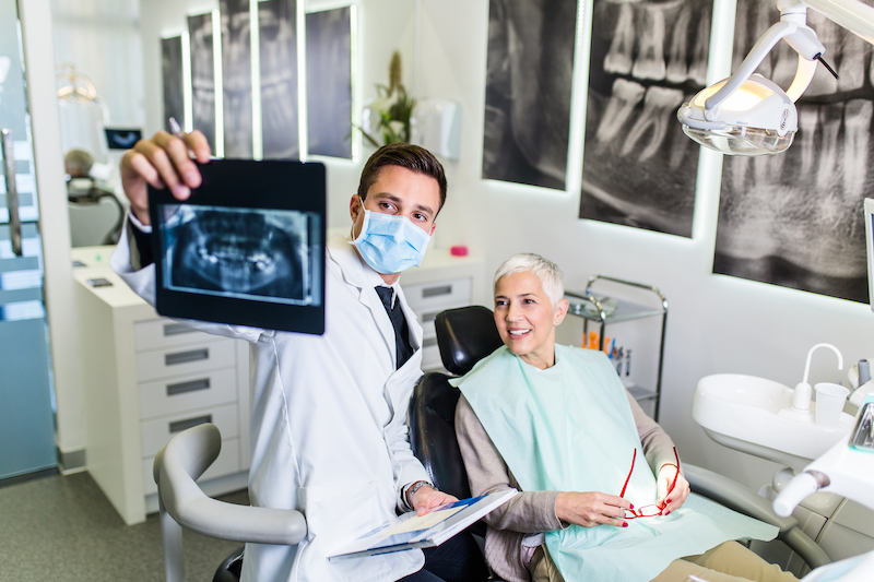 male dentist and elderly female patient