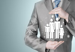 Photograph of a person in a suit with their hands cupped. Graphic of a man, woman, and two children.