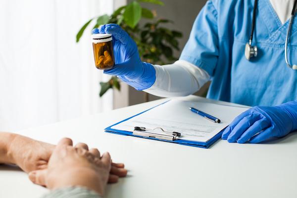 patient receiving prescription from doctor