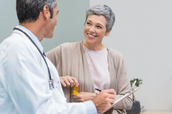 patient and doctor discussing prescription plan